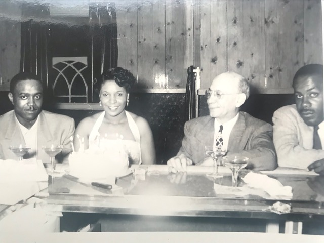 Birthday (?) at The Pythodd, four people at the Pythodd bar. Man second from right may be Roy King.