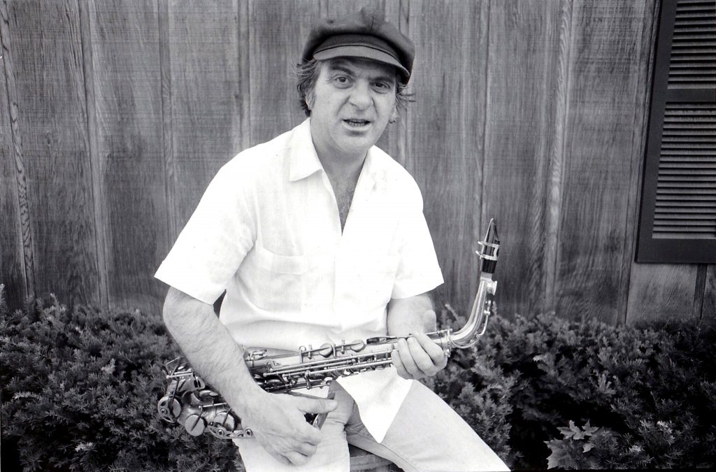 Black and white photo of Joe Romano with sax