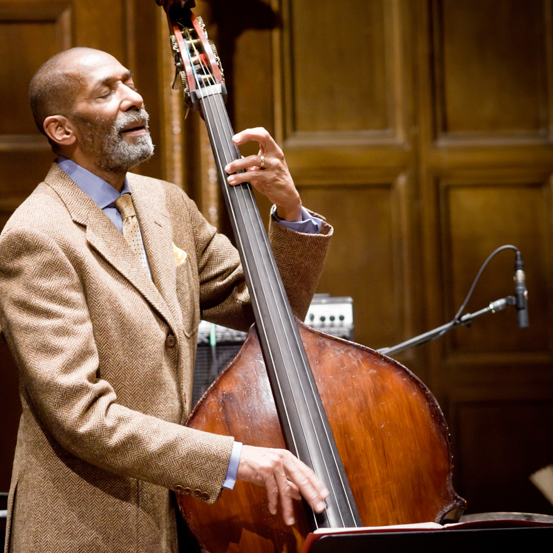 Full color image of Ron Carter performing on his bass.