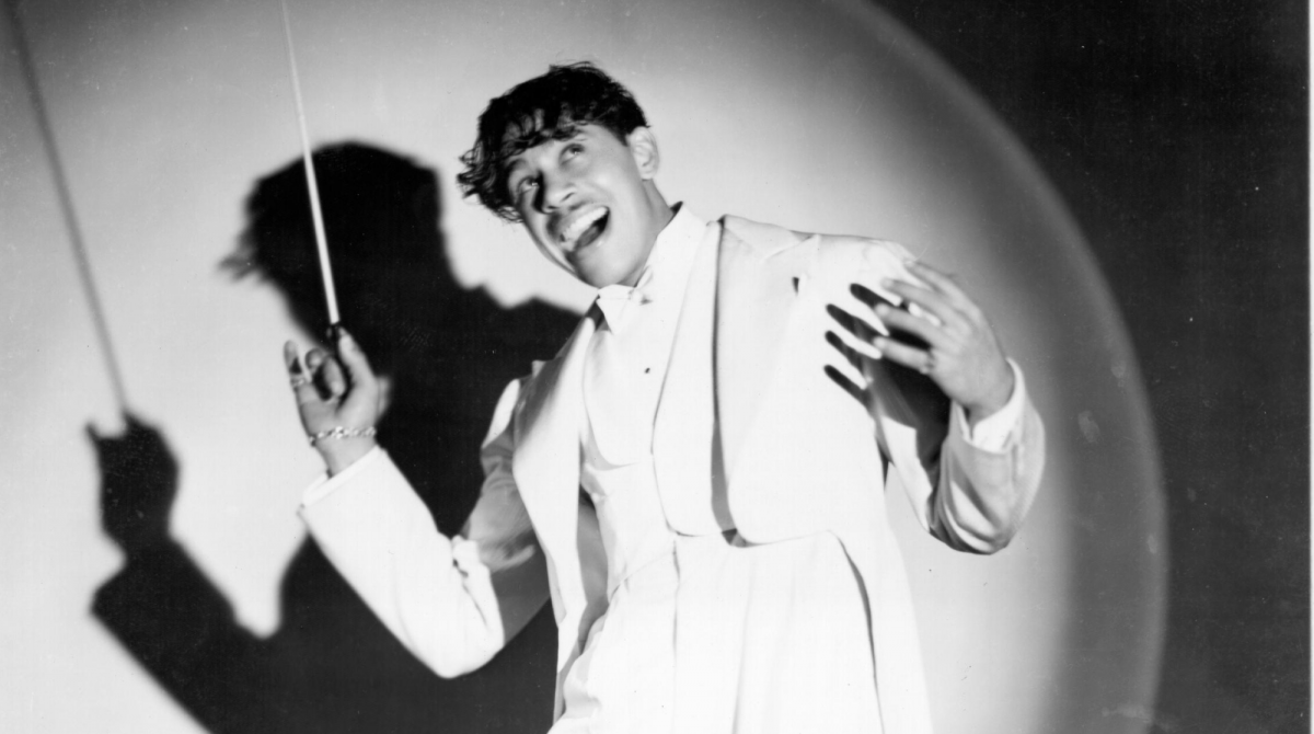 Black and white photo of Cab Calloway conducting