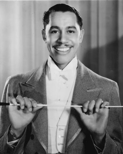 Black and white photo of a young Cab Calloway holding his baton stick