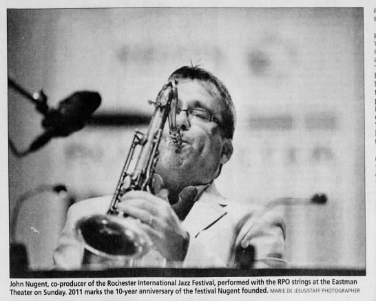 """Image from the Rochester International Jazz Festival. Caption reads, """"John Nugent, co-producer of the Rochester International Jazz Festival, preformed with the RPO strings at the Eastman Theatre on Sunday. 2011 marks the 10-year anniversary of the festival Nugent founded."""""""