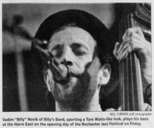 """Image from the Rochester International Jazz Festival. Caption reads, """"Vadim 'Billy' Novik of Billy's Band, sporting a Tom Waits-like look, plays his bass at the Harro East on the opening day of the Rochester Jazz Festival on Friday."""""""