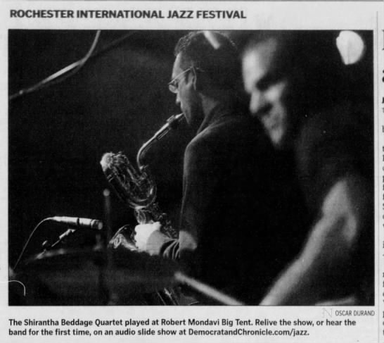 """Image from the Rochester International Jazz Festival. Caption reads, """"The Shirantha Beddage Quartet played at Robert Monday Big Tent. Relive the show, or hear the band for the first time, on an audio slide show at DemocratandChronical.com/jazz."""""""
