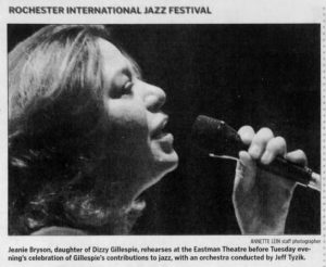 """Image from the Rochester International Jazz Festival. Caption reads, """"Jeanie Bryson, daughter of Dizzy Gillespie, rehearses at the Eastman Theatre before Tuesday evening's celebration of Gillespie's contributions to jazz, with an orchestra conducted by Jeff Tyzik."""""""