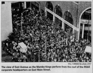 """Image from the Rochester International Jazz Festival. Caption reads, """"The view of East Avenue as the Mambo Kings perform on the roof of the corporate headquarters of RG&E on East Main Street."""""""