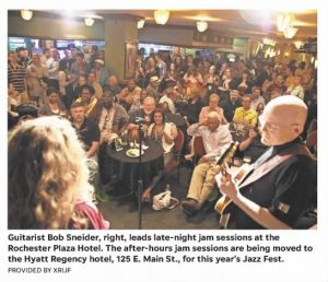 """Image from the Rochester International Jazz Festival. Caption reads, """"Guitarist Bob Sneider, right, leads late-night jam sessions at the Rochester Plaza hotel. The after-hours jam sessions are being moved to the Hyatt Regency Hotel, 125 Main St., for this year's jazz fest."""""""