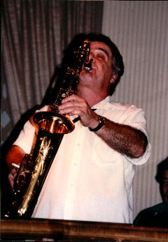 Color image of Joe Romano playing his sax