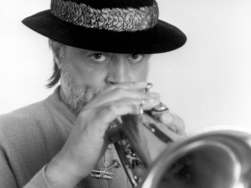 Black and white photo of Chuck Mangione playing the flugal horn