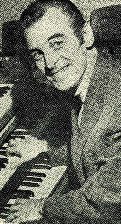 Black and white photo of Doug Duke playing the piano