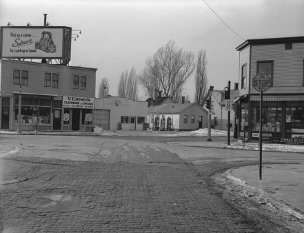 A black and white photo depicts the street corner where Hi-Land Inn was.