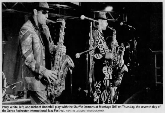 """Image from the Rochester International Jazz Festival. Caption reads, """"Perry White, left, and Richard Underhill play with the Shuffle Demons at Montage Grill on Thursday, the seventh day of the Xerox Rochester International Jazz Festival."""""""