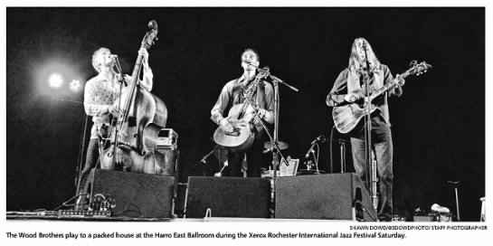 """Photo from the Rochester International Jazz Festival. Caption reads, """"The Wood Brothers play to a packed house at the Harro East Ballroom during the Xerox Rochester International Jazz Festival Saturday."""""""